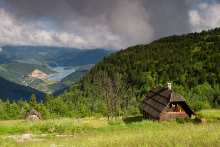 architecture bungalow: Traditional wooden house in Mokra Gora
