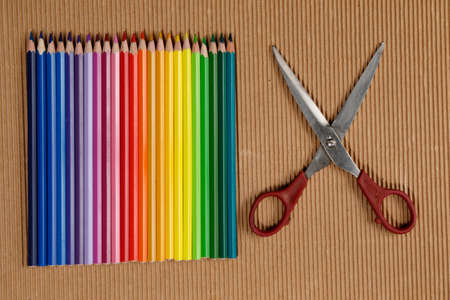 clippers: Multicolored crayons and clippers on wrinkly brown paper