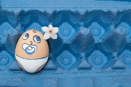 pampers: Lonely cute egg baby face in pampers with pacifier in blue panel
