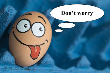 dont worry: Do not worry egg face in blue panel Stock Photo