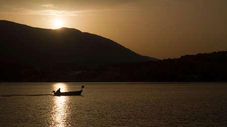 siluet: Siluet of Spanish fisherman and his boat Stock Photo