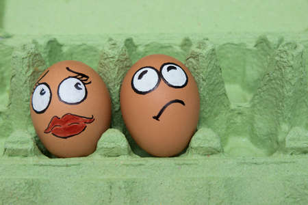 happening: Fractious boy and girl egg face on green panel