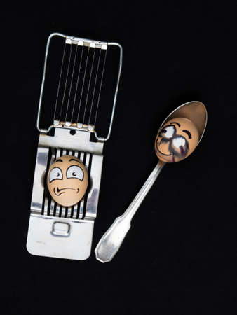 happening: Two  horror egg face on the cutter other in the spoon