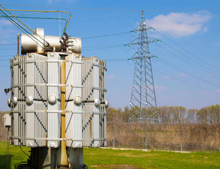 dielectric: High voltage power line and transformers in electrical substation Stock Photo