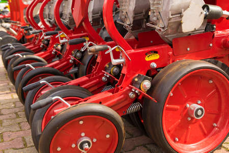 agricultural engineering: Red seeder machinery for a Farming Tractor