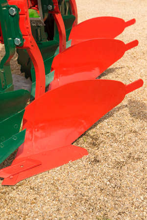 plough: Detail of red plough for a Farming Tractor