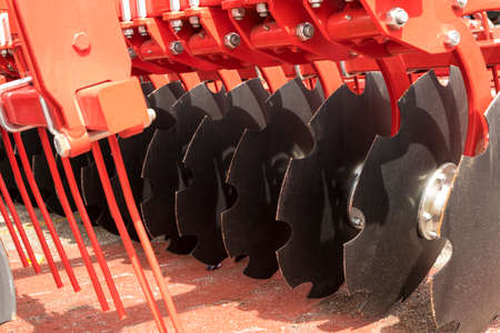 harrow: A Large Disc Harrow Trailer for a Farming Tractor Stock Photo
