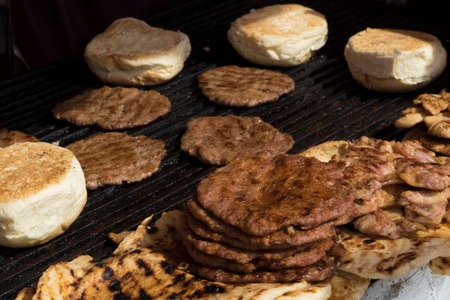 barbequing: Hamburgers.   juicy meat and bread on barbeque Stock Photo