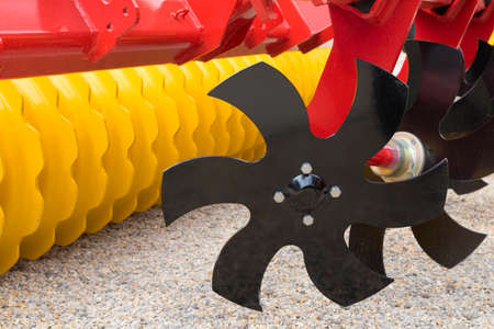 harrow: Red and yellow  Disc Harrow Trailer for a Farming Tractor Stock Photo