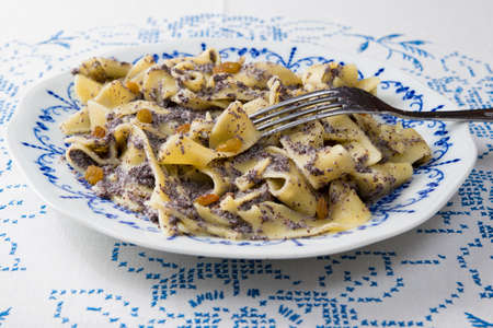 Poppy seed pasta on a plate traditional hungarian meal