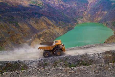 Yellow dump truck on coper surface mining, Bor Serbia Stock Photo
