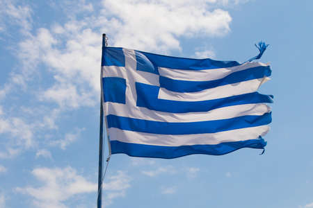 flutter: Greek flag flutter on wind against blue sky with white clouds Stock Photo