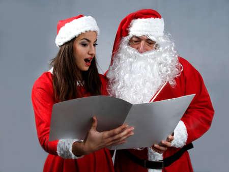 sexy christmas elf: Santa claus and deputy reading wish book