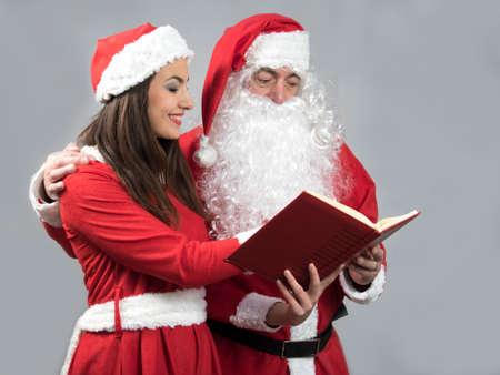 sexy xmas elf: Santa claus and deputy reading wish book