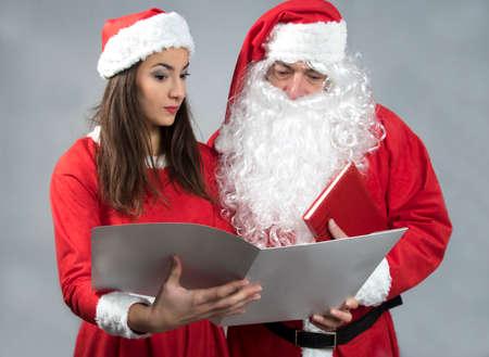 Santa claus and deputy wonder  reading wish book