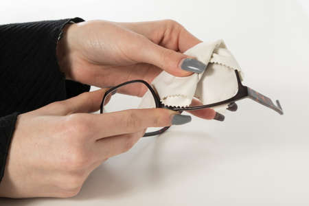 Glasses cleaning with fine microfiber cloth