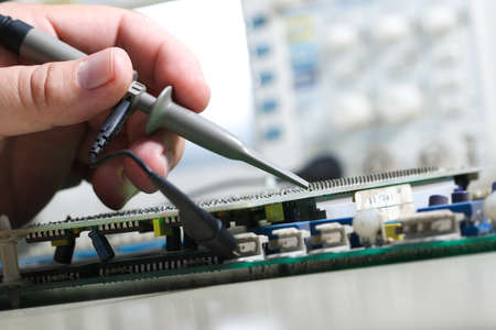 oscilloscope: Testing electronic devices with oscilloscope in laboratory Stock Photo