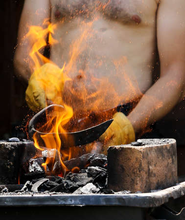 forge: Fire in blacksmith forge Stock Photo