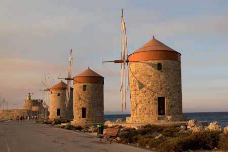 Two traditional windmill in Mandraki port of Rhodes,Greece Stock Photo