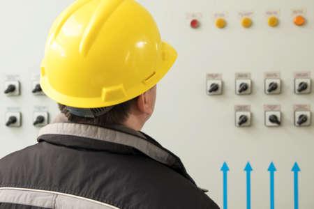 dispatcher: Technician reading instruments in power plant control center