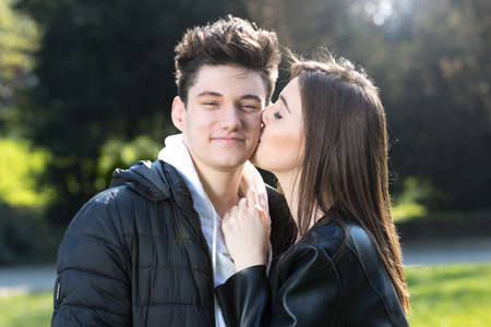 A girl kissing a boy in the cheek, Valentines day