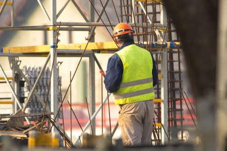 Worker in orange helmet at the construction site