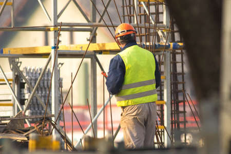 Worker in orange helmet at the construction site