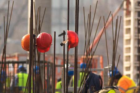 Three Red helmets on metal framework , job brek Stock Photo