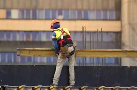 Labour transport steel beam at the construction site