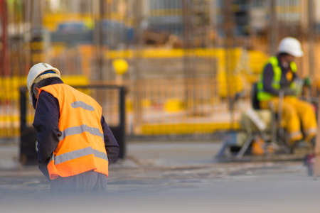 Worker with Concrete Pavements machine at the constructio site
