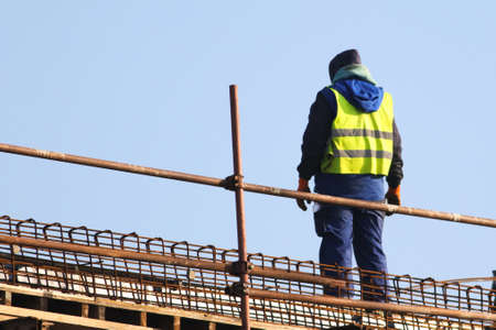 Worker at the construction site ower blue sky