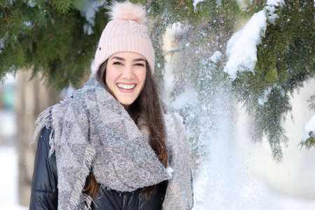 Portrait of  Smiling girl in winter with snow and christmas tree Stock fotó