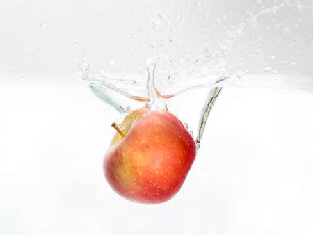 Red Apple spash in water on white background