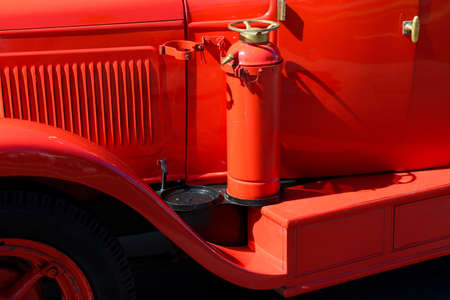 Detail of old vintage firetruck with fire extinguisher