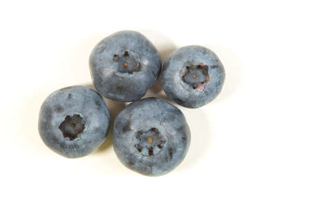 Top view of four fresh blueberries on white Imagens