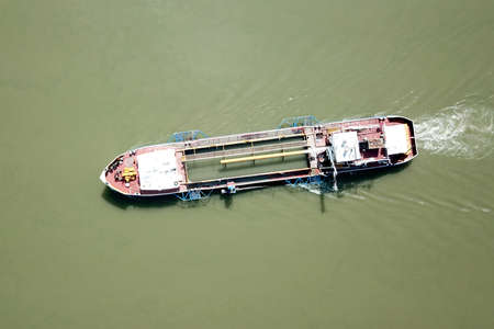 Top view of old cargo shep in the river Banco de Imagens