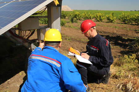 Two electricians are controling solar panel