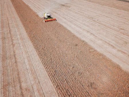 Aerial view of combine harvesting on soya field
