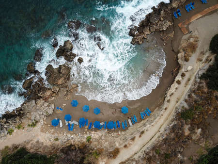 Top view on the beach with umbrellas and sunbeds after the storm
