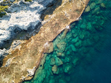 View from above of the turquoise Mediterranean sea and rocks