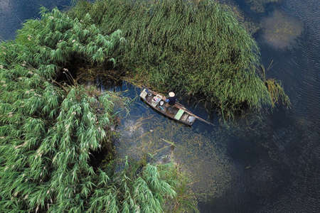 Top view from an old fisherman in a wooden boat