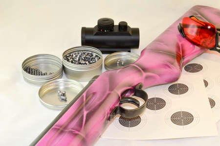airgun: Airbrushed old airgun with accessories and pellets.