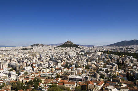 The city of Athens is seen here with Lycabettus Hill Stock Photo