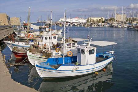 fisherman on boat: Heraklion port and venetian harbour in island of Crete, Greece