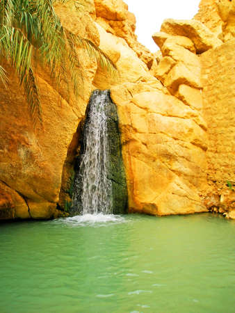 Waterfall in mountain oasis Chebika at border of Sahara, Tunisia, Africa