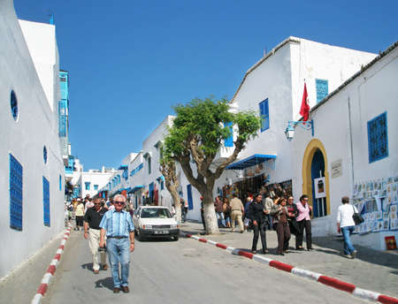 Tunisia, Sidi Bou Said - September 13, 2008, The blue and white village of Sidi Bou Said has long been a bohemian sanctuary- and its beauty now attracts wealthy Tunisians and inquisitive tourists alike