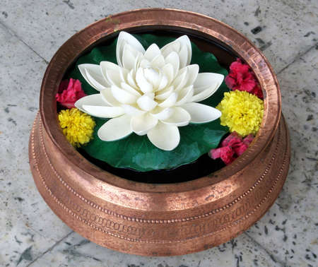 ikebana: Lotus in Copper Vase with colored flowers