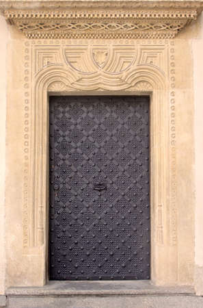 cracow: Old door with ornament in stone wall. Royal Wawel Castle, Cracow. Poland