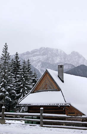 House in Zakopane and mountain as background photo