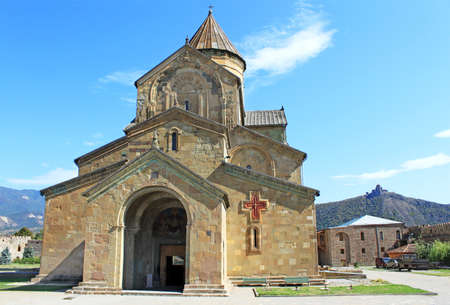 Svetitskhoveli Cathedral in Mtskheta and Jvari monestery behind, Georgia Stock Photo
